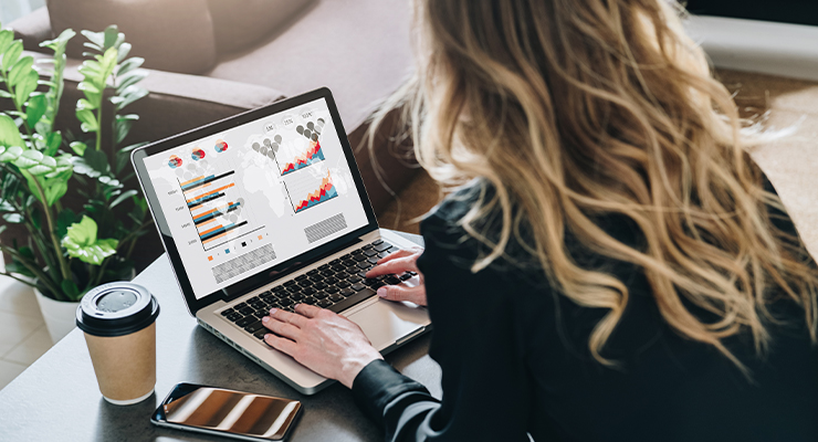 Female employee on her laptop taking an online marketing analytics course to boost her business.