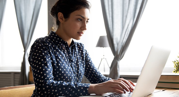 Female student attempting to get her Microsoft certifications on her laptop in order to gain academic benefit.