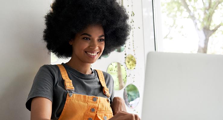 Gen Z employee looking for local opportunities on her laptop.