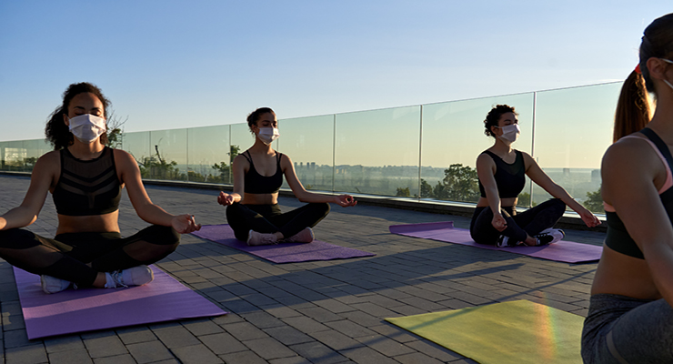 Employees maintaining a social life while working remotely b going to yoga together.