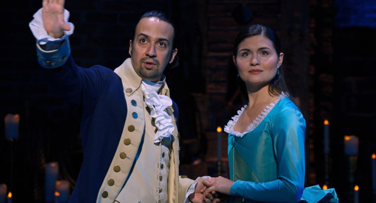 Actors in the Hamilton play playing a scene about the importance of listening which can be carried over to being a good listener in professional development.