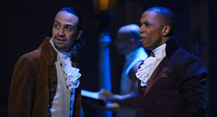 Two male actors in the Hamilton play acting out a scene about knowing when to embrace freedom which can be carried over to professional development and knowing when to shift careers.
