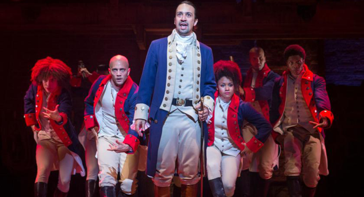 Actors in the Hamilton play portraying a scene about taking a shot at your passion.