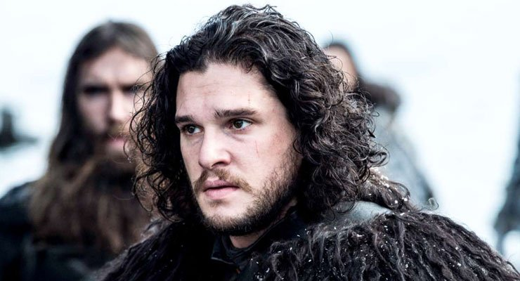 Jon Snow outside surrounded by other men during a scene in Game of Thrones