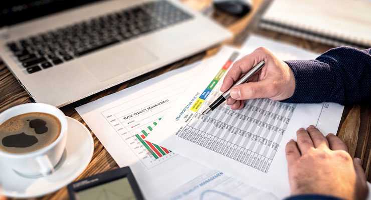 Professional employee looking over a business expense document