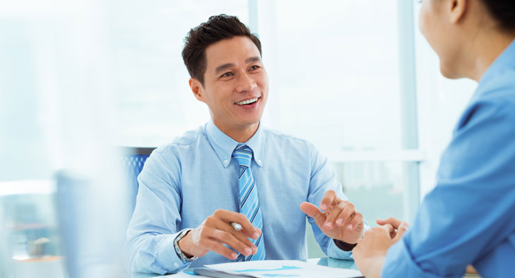 Human resources professional talking to an employee