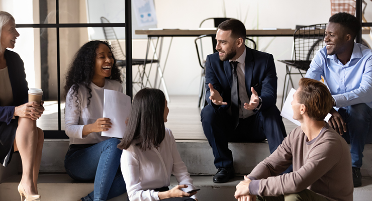 Employees engaging with one another in a work meeting.